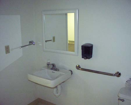 bathroom on handicap accessible bathroom with rails sink toilet sink